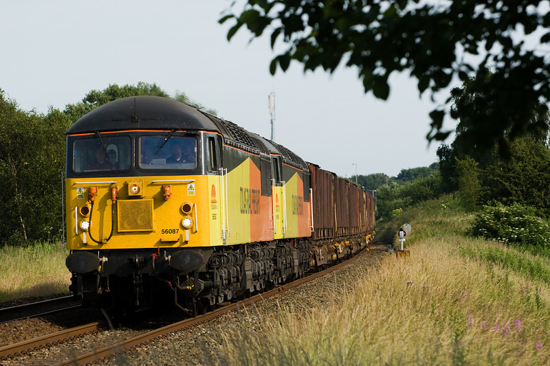 56087 and 56107 double head 6C37 Chirk-Carlisle empty log carriers past Blackrod.   The box had been recently closed and demolished a few weeks previously - 14 July 2013